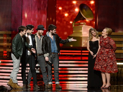 Musicians Ben Lovett, Marcus Mumford, Ted Dwane and Winston Marshall of Mumford & Sons accept the Album of the Year award for 'Babel' with presenter Adele onstage at the 55th Annual GRAMMY Awards at Staples Center on February 10, 2013, in Los Angeles, California. (credit: Kevork Djansezian/Getty Images)