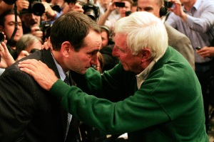 Bob Knight, who coached at Army in 1968, congratulates Mike Krzyzewski, one of his former players, after the latter won his 903rd game in November 2011. (credit: by Patrick McDermott/Getty Images)