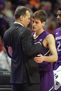 Northwestern coach Chris Collins hugs senior Dave Sobolewwski as he is taken out of the game during the Wildcats' second-round loss to Indiana in the Big Ten tournament in Chicago on March 12. (credit: Jonathan Daniel/Getty Images)