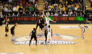 William and Mary tips off the CAA final on March 9 against  Northeastern in Baltimore. (credit: Mitchell Layton/Getty Images)