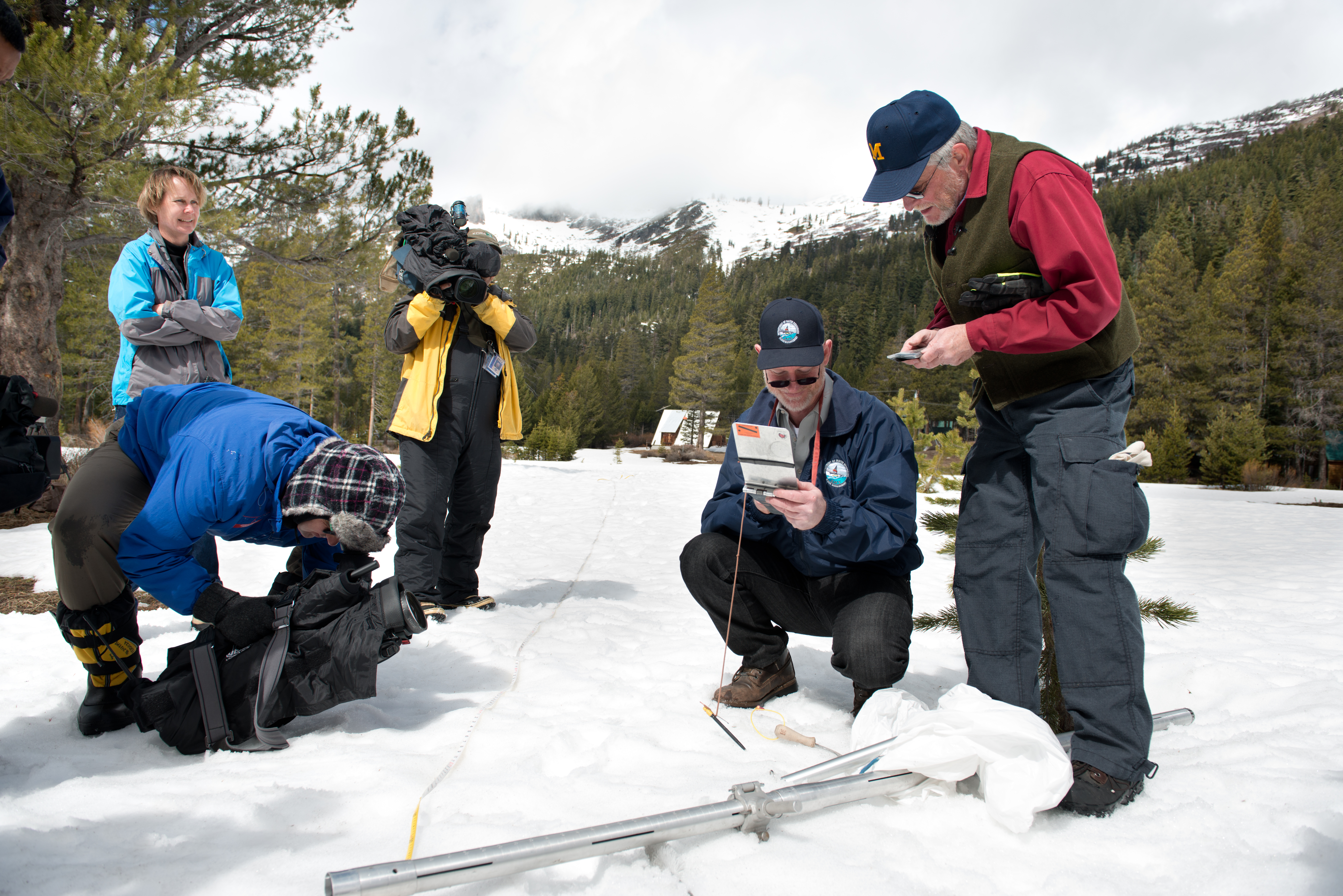 This photo from March 2013 shows Keith Swanson (DWR Chief of Division of Flood Management) and Frank Gehrke (DWR Chief of Snow Surveys) conduct the annual snow survey at Phillips Station. This year, the location had no visible snow covering the ground. (Photo courtesy Gov. Jerry Brown's Office)
