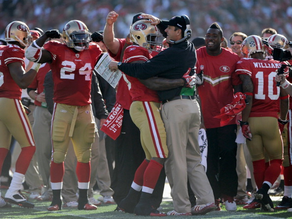 Vernon Davis #85 of the San Francisco 49ers celebrates with head coach Jim Harbaugh after Davis scored a touchdown in the first quarter against the New Orleans Saints during the NFC Divisional playoff game at Candlestick Park. (Photo by Thearon W. Henderson/Getty Images)