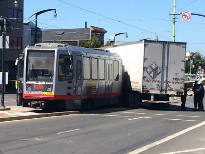 Scene of a collision between a Muni light rail vehicle and a big rig on Third St. and Innes Ave. in San Francisco, August 1, 2014. (CBS)