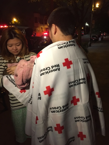 Residents displaced from their Oakland apartment receive Red Cross blankets. (CBS SF)
