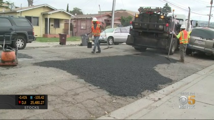 """An Oakland public works crew fills potholes as part of a so-called """"blitz"""" on May 28, 2019. (CBS)"""