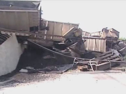 A Union Pacific freight train hauling coal from Wyoming to Wisconsin derailed near the border between north suburban Glenview and Northbrook on July 4, 2012. A railroad bridge also collapsed in the wreck. (Credit: CBS)