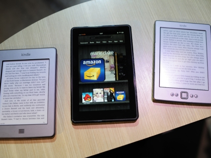 A collection of Amazon Kindle products rest on a desk. (credit: EMMANUEL DUNAND/AFP/Getty Images)