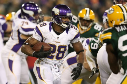 GREEN BAY, WI - JANUARY 05:  Running back Adrian Peterson #28 of the Minnesota Vikings runs the ball against the Green Bay Packers in the second quarter during the NFC Wild Card Playoff game at Lambeau Field on January 5, 2013 in Green Bay, Wisconsin.  (Photo by Andy Lyons/Getty Images)