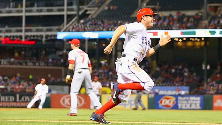Ian Kinsler #5 of the Texas Rangers scores against the Los Angeles Angels in the first inning at Rangers Ballpark in Arlington on September 26, 2013 in Arlington. (credit: Ronald Martinez/Getty Images)