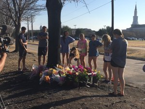 Friends and family laid flowers at the site of the deadly crash in Plano. (Yona Gavino/Twitter)