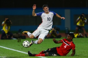 COUVA, TRINIDAD AND TOBAGO - OCTOBER 10: Christian Pulisic (L) of the United States mens national team is tackled by Kevon Villaroel (R) of Trinidad and Tobago during the FIFA World Cup Qualifier match between Trinidad and Tobago at the Ato Boldon Stadium on October 10, 2017 in Couva, Trinidad And Tobago.