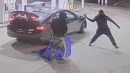 The suspects smashing the front door of the gas station. (Credit: Placer Sheriff)