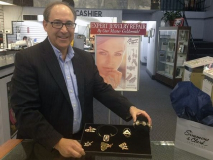 Michael Simmons shows off student-made jewelry on display at Simmons and Clark Jewelers in downtown Detroit. (Credit: Vickie Thomas/WWJ Newsradio 950)