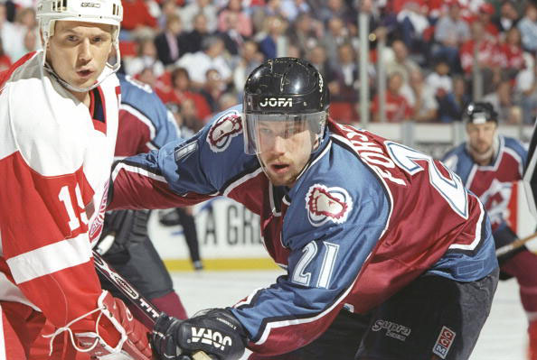 Center Peter Forsberg of the Colorado Avalanche checks center Steve Yzerman of the Detroit Red Wings during a playoff game at the Joe Louis Arena in Detroit, Michigan. The Red Wings won the game 6-0. Mandatory (credit: Robert Laberge /Allsport/Getty Images)