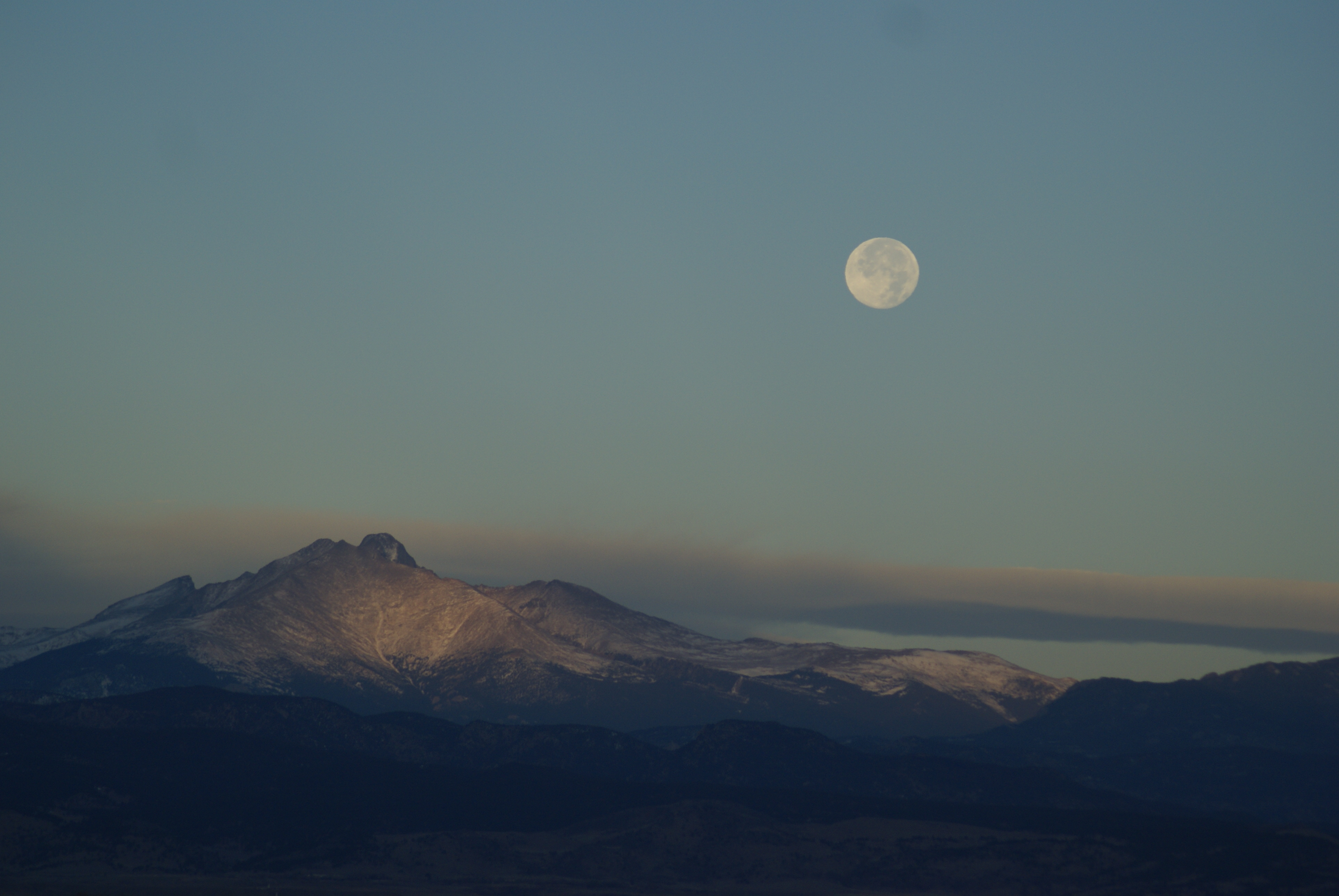 """Barbara Kerns from Thornton sent in this photo of the """"Beaver Moon"""" setting over  Longs Peak."""