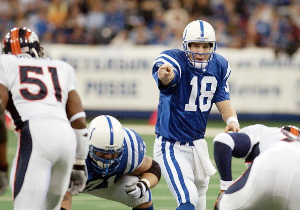 Peyton Manning #18 of the Indianapolis Colts signals to his lineman during his NFL game with the Denver Broncos at the RCA Dome in Indianapolis on Jan. 6, 2002. (credit: Ron Hoskins\Getty Images)