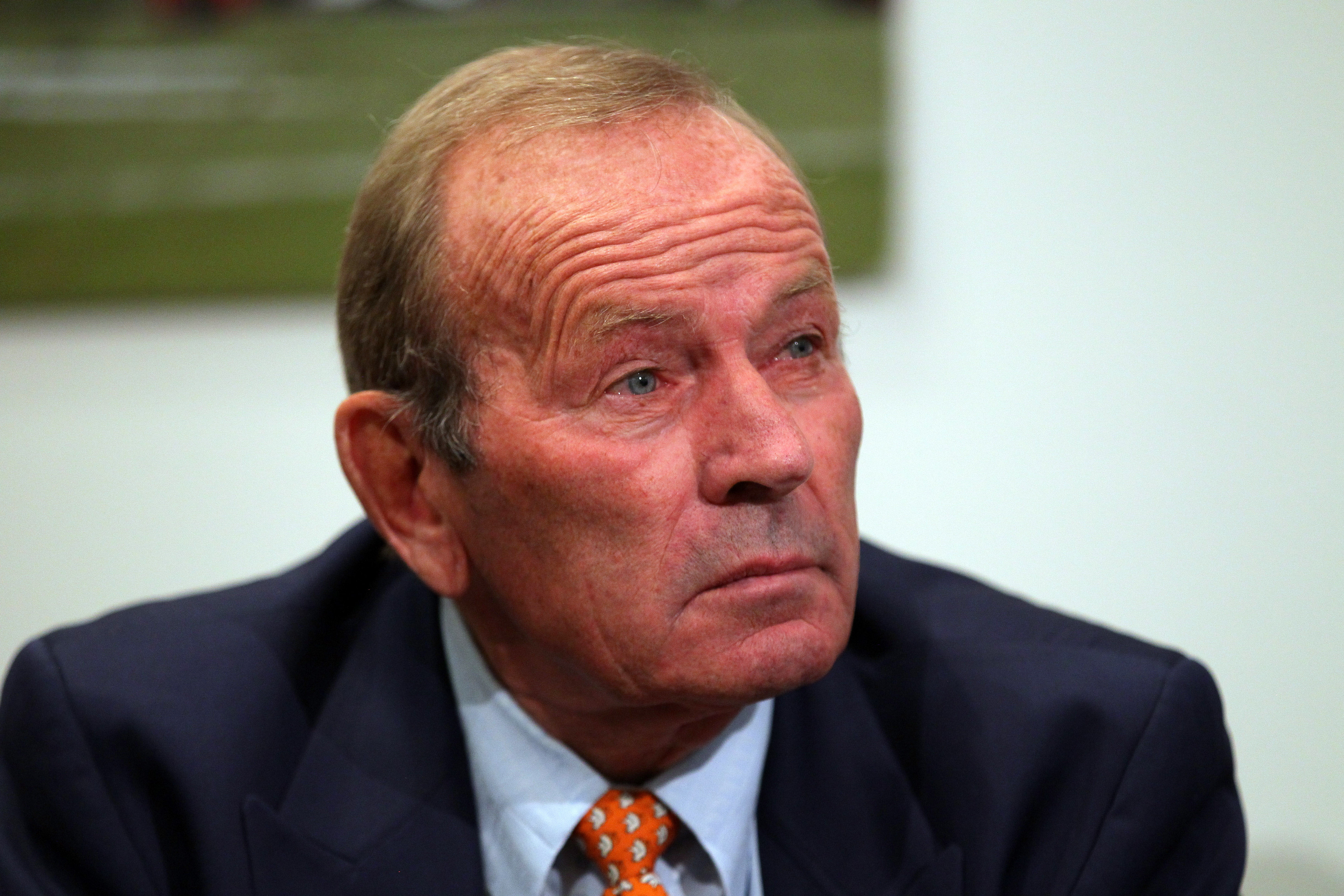 Majority owner, president, and CEO Pat Bowlen of the Denver Broncos watches as quarterback Peyton Manning speaks during a news conference announcing Manning's contract with the Denver Broncos in the team meeting room at the Paul D. Bowlen Memorial Broncos Centre on March 20, 2012 in Englewood.  (Photo by Doug Pensinger/Getty Images)