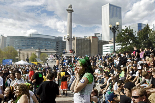Thousands gather to celebrate the state's medicinal marijuana laws and collectively light up at 4:20 p.m. in Civic Center Park April 20, 2012 in Denver. (Photo by Marc Piscotty/Getty Images)