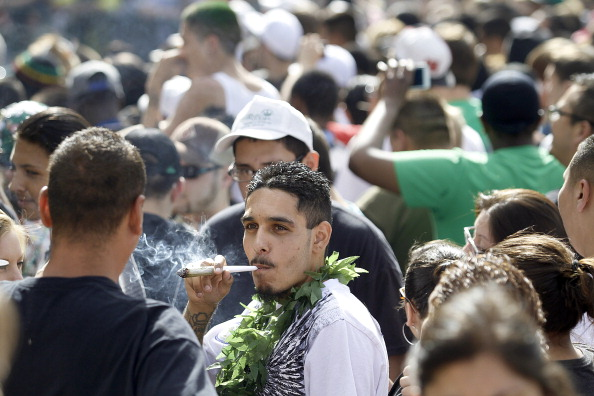 Thousands of supporters of legalized marijuana light up at exactly 4:20 p.m in Civic Center Park April 20, 2012 in Denver. (Photo by Marc Piscotty/Getty Images)