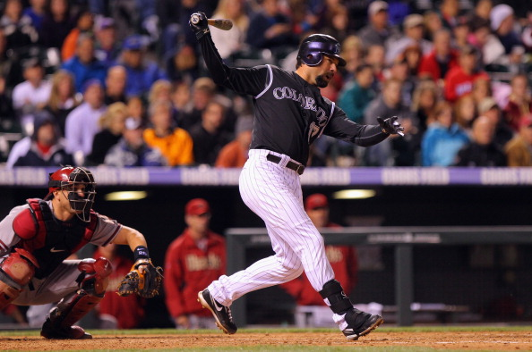 Todd Helton of the Colorado Rockies hits a two RBI single against the Arizona Diamondbacks at Coors Field on April 13, 2012.  (Photo by Doug Pensinger/Getty Images)