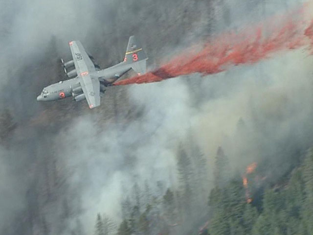 A C-130 drops slurry on the Flagstaff Fire. (credit: CBS)