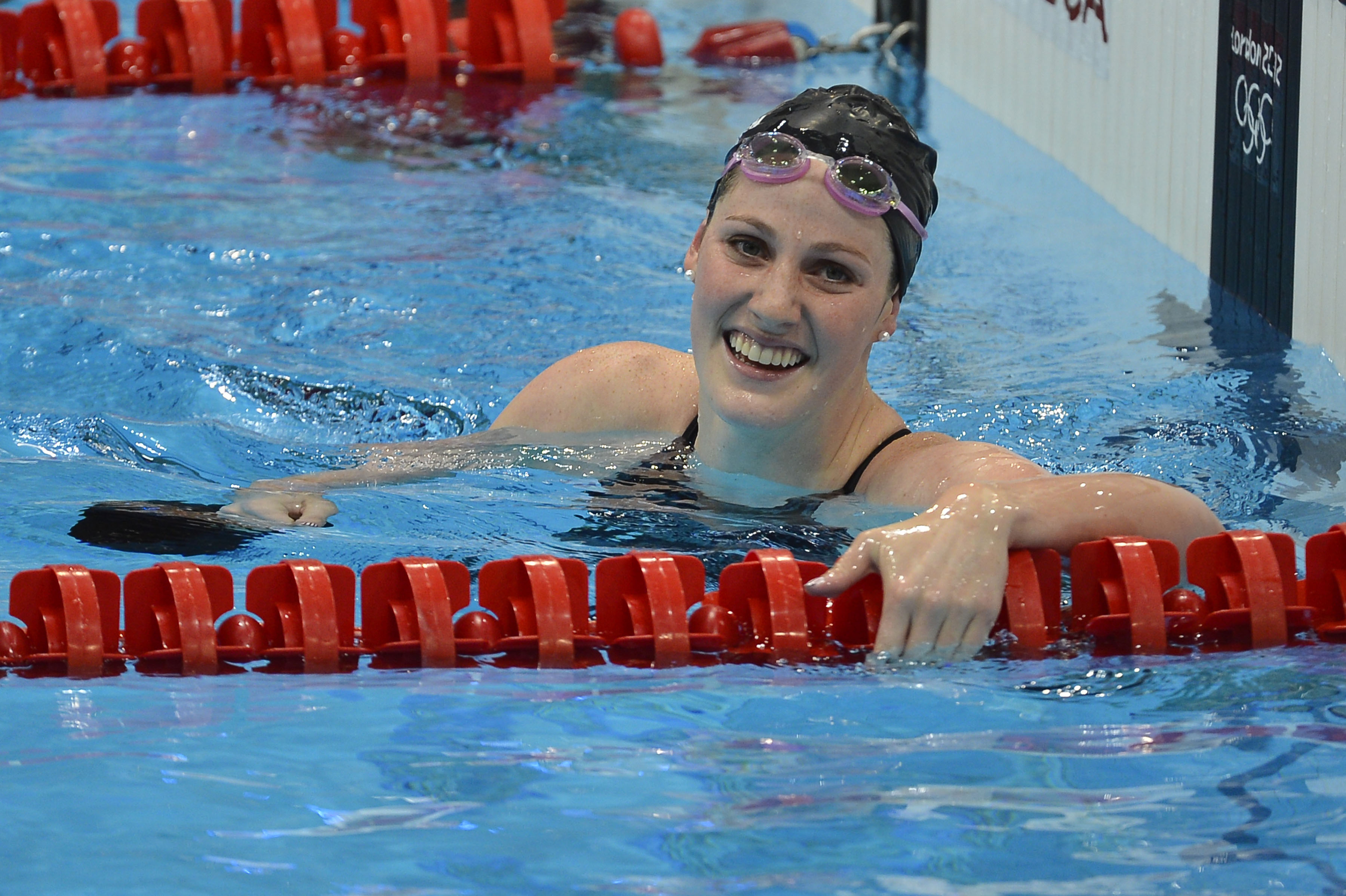 US swimmer Missy Franklin celebrates winning the women's 100m backstroke final swimming event at the London 2012 Olympic Games on July 30, 2012 in London. (credit: ODD ANDERSEN/AFP/GettyImages)