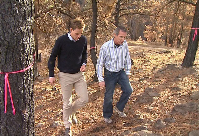 Pastor Randy Rivers, right, walks with CBS4's Ty Brennan. (credit: CBS)
