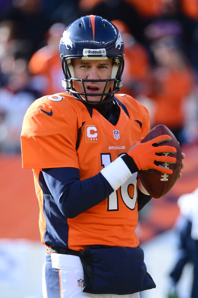 Peyton Manning #18 of the Denver Broncos warms up prior to the game against the Kansas City Chiefs (Photo by Garrett W. Ellwood/Getty Images)