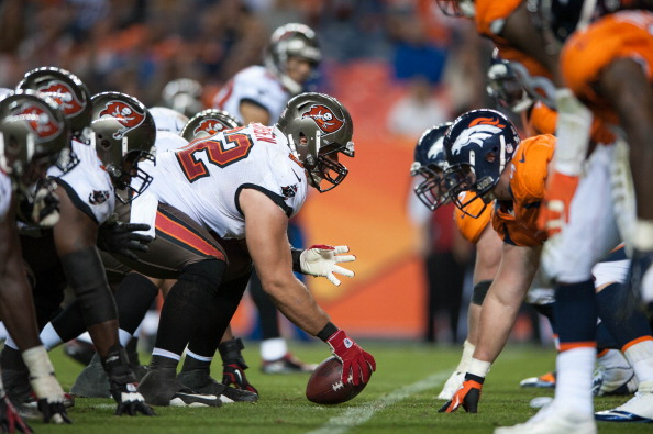 DENVER, CO - DECEMBER 2: Center Ted Larsen #62 of the Tampa Bay Buccaneers lines up against the Denver Broncos defense during a game at Sports Authority Field Field at Mile High on December 2, 2012 in Denver, Colorado. (Photo by Dustin Bradford/Getty Images)