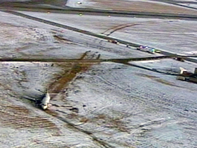 An image of the plane before it was hauled away from the runway area (credit: Copter4)