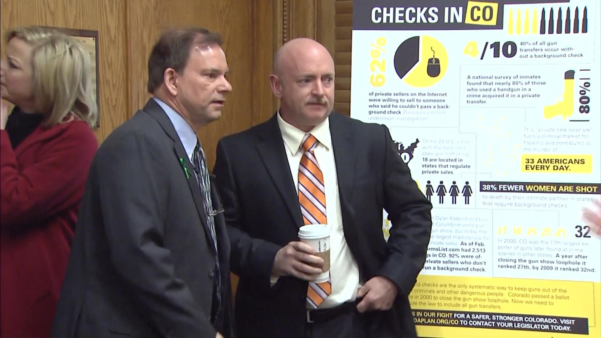 Daniel Mauser, left, who lost a son in the Columbine High School massacre, speaks with Mark Kelly in the Colorado capitol. (credit: CBS)