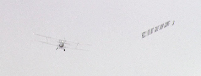 A plane flies over the capitol and spells out the opposition to new gun control proposals. (credit: CBS)
