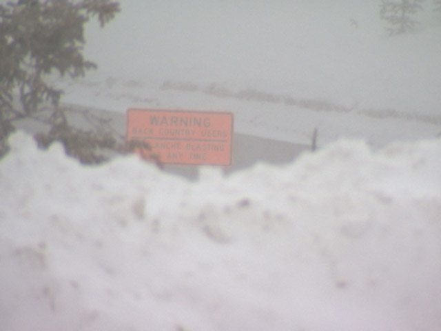 An avalanche warning sign on Loveland Pass near the deadly avalanche. (credit: CBS)