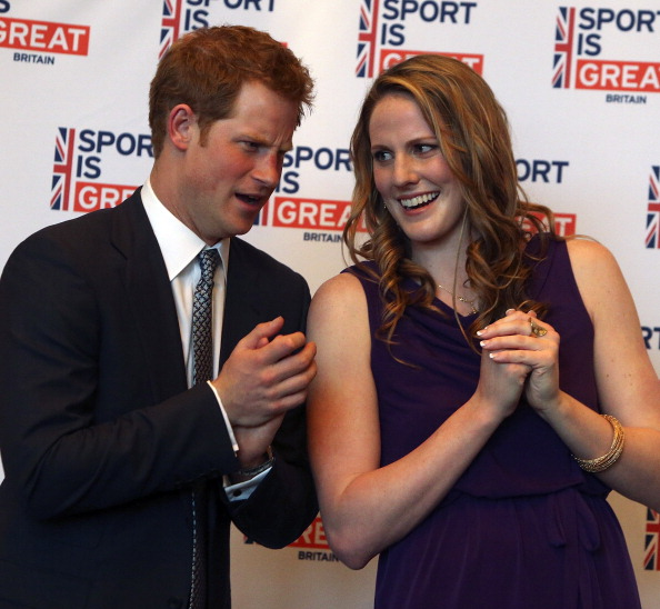 HRH Prince Harry (L) talks with Olympic gold medalist Missy Franklin at a reception at the Sanctuary Golf Course on May 10, 2013 in Sedalia, Colorado. HRH will be undertaking engagements on behalf of charities with which the Prince is closely associated on behalf also of HM Government, with a central theme of supporting injured service personnel from the UK and US forces. (Photo by Ed Andrieski - Pool/Getty Images)