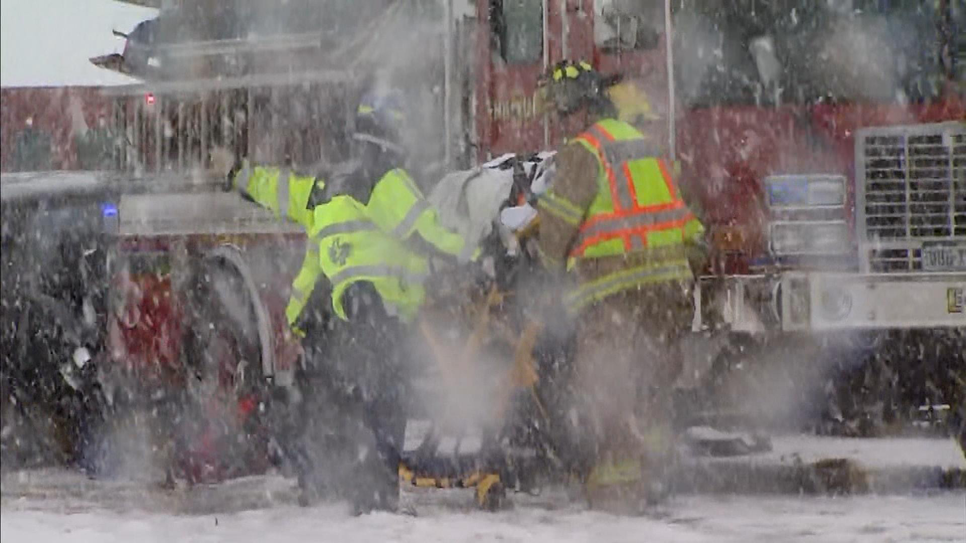 A person being taken to the hospital after the crash (credit: CBS)