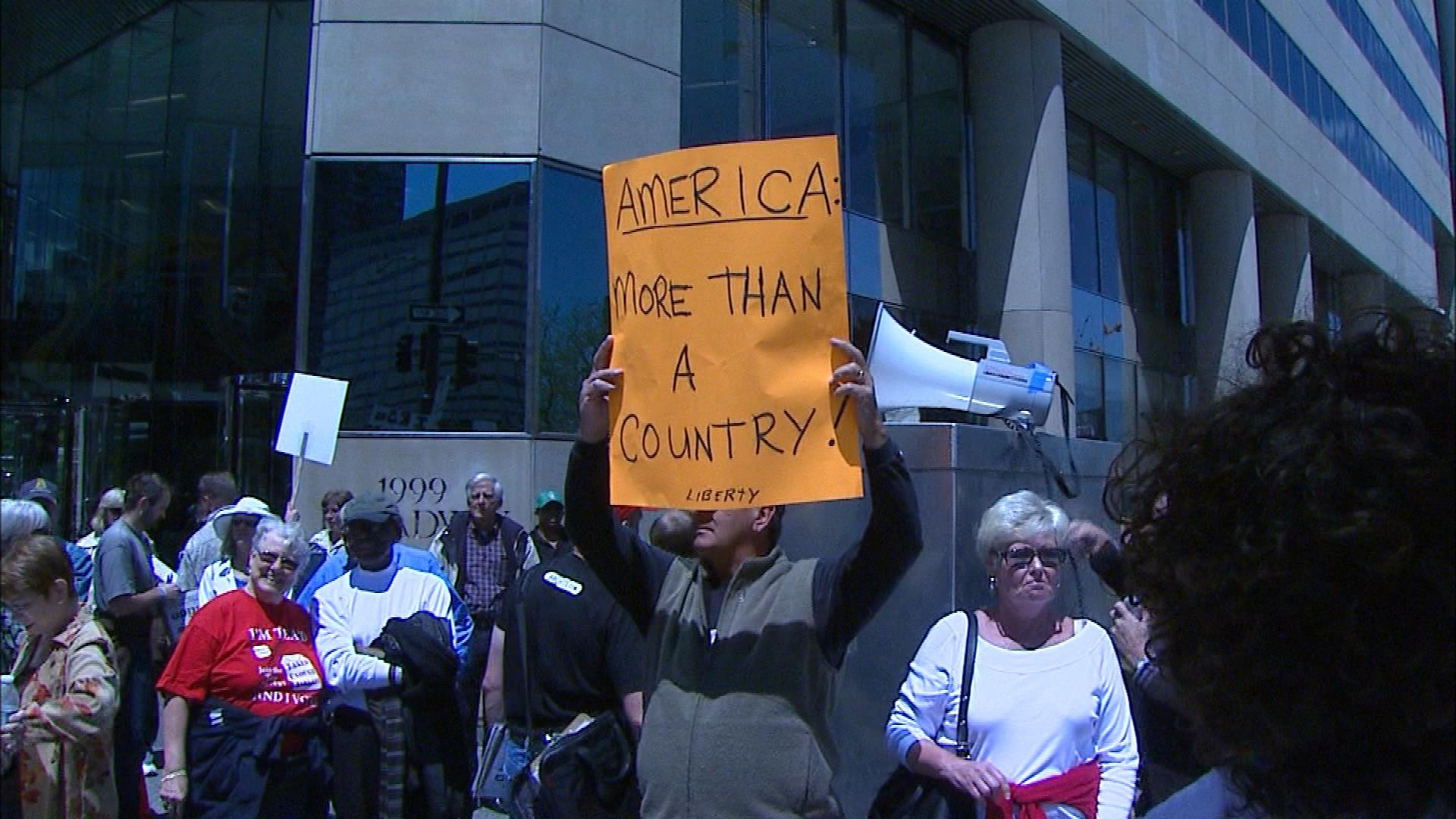 The Tea Party protest the IRS office in Denver on Tuesday (credit: CBS)