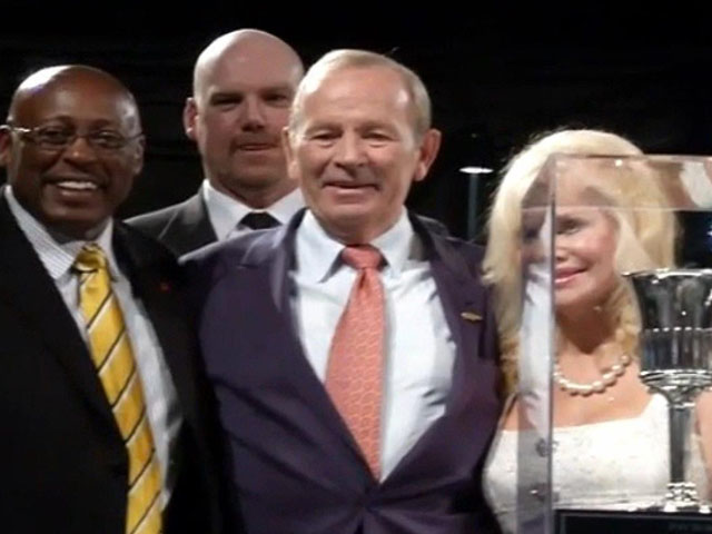 Pat Bowlen surrounded by Broncos Hall of Famers and his wife Annabel Bowlen in 2013. (credit: Denver Broncos)