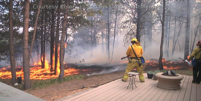 A firefighter battles flames in the Black Forest Fire in 2013. (credit: Colorado Springs Fire Department)