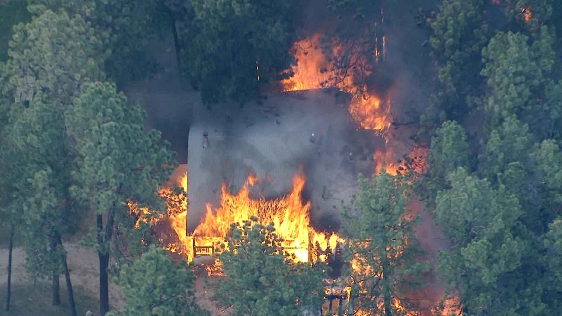 A house burning Wednesday evening (credit: CBS)
