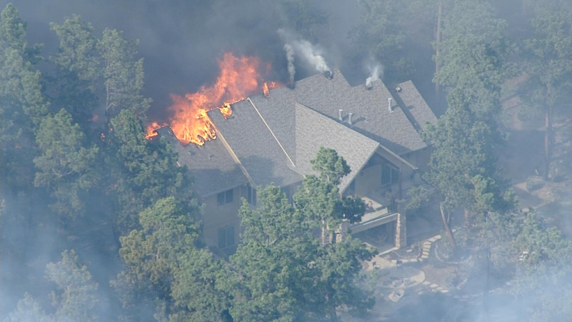 A house burning last summer (credit: CBS)