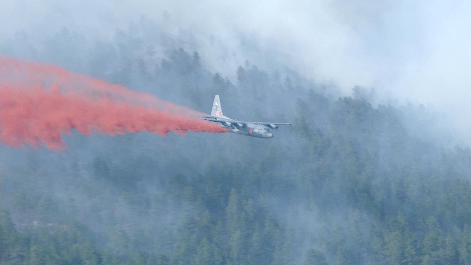 A C-130 making a drop at the West Fork Complex Fire on Monday (credit: CBS)