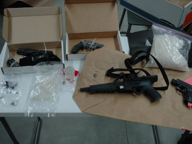 "Drugs and guns seized in ""Operation Bad Nickname"" (credit: Longmont Police)"