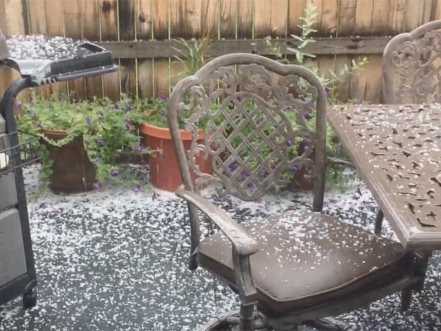 Paul Pack sent in this picture of hail on his deck near Peoria and Mississippi (credit: Paul Pack)