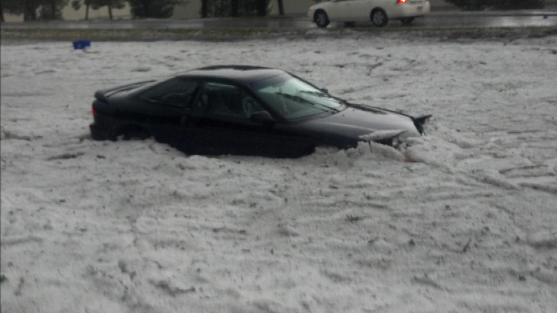 A mix of hail and floodwaters buried and heavily damaged Bryndon Jackson's car in Littleton. (credit: CBS)