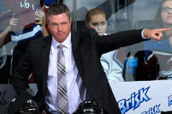 Head coach Patrick Roy of the Colorado Avalanche leads his team against the Anaheim Ducks during preseason action at Pepsi Center on September 18, 2013 in Denver, Colorado.  (Photo by Doug Pensinger/Getty Images)