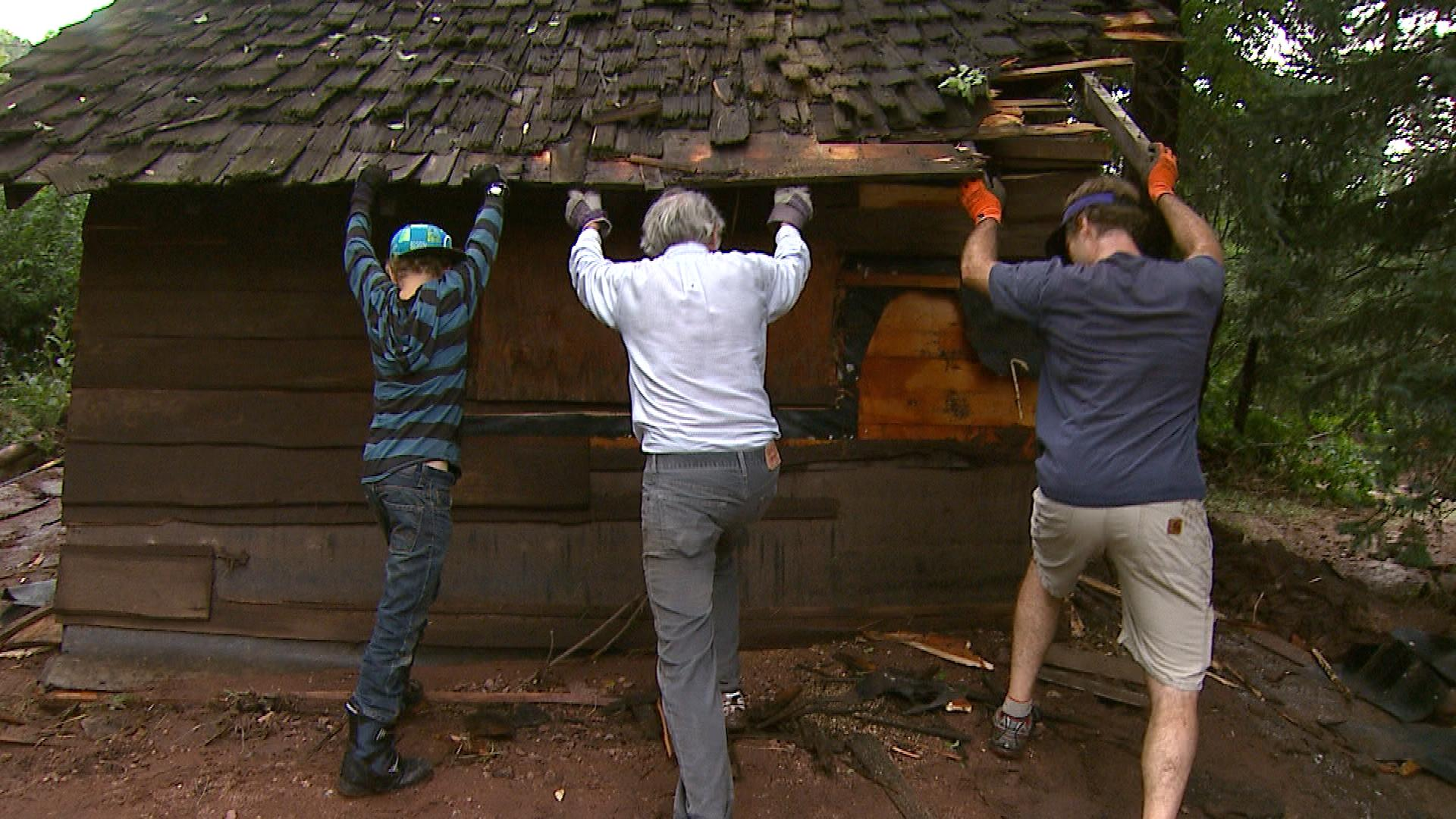 Residents in Boulder clean up on Friday. (credit: CBS)