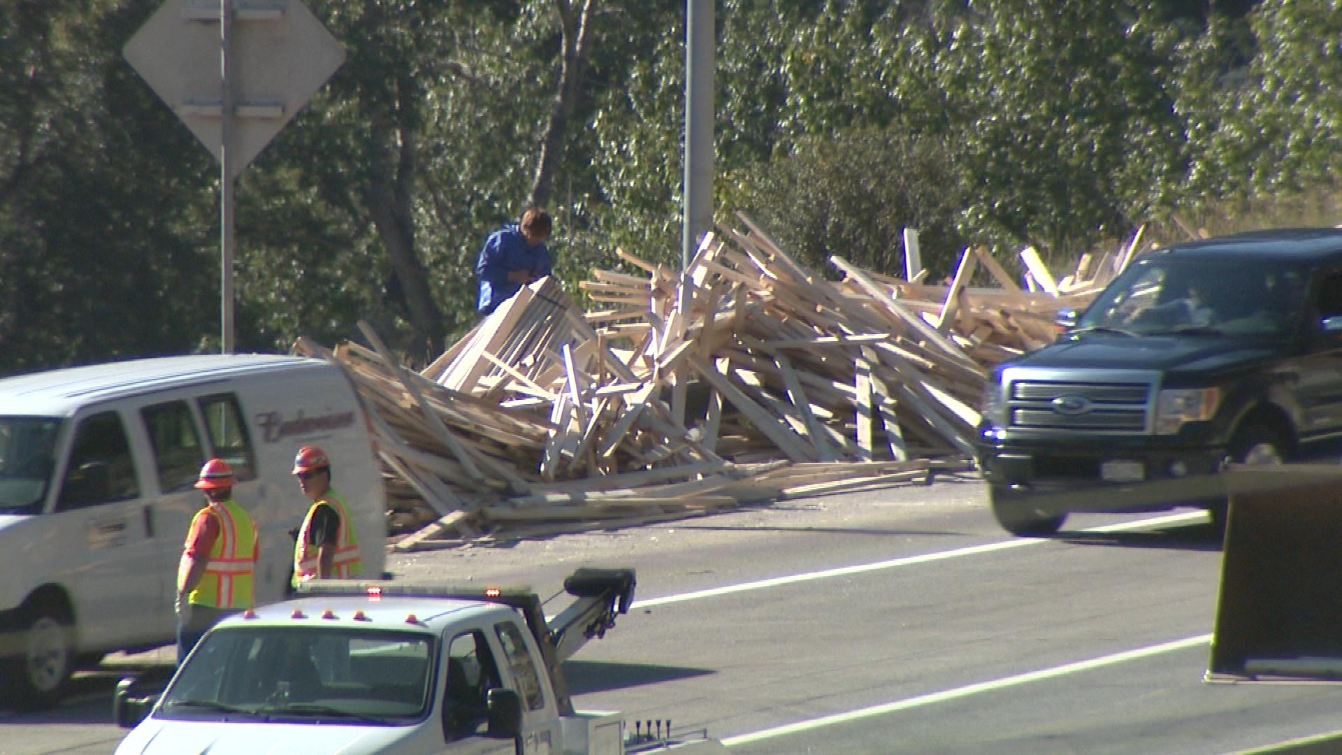 Lumber on the highway several hours after the crash (credit: CBS)