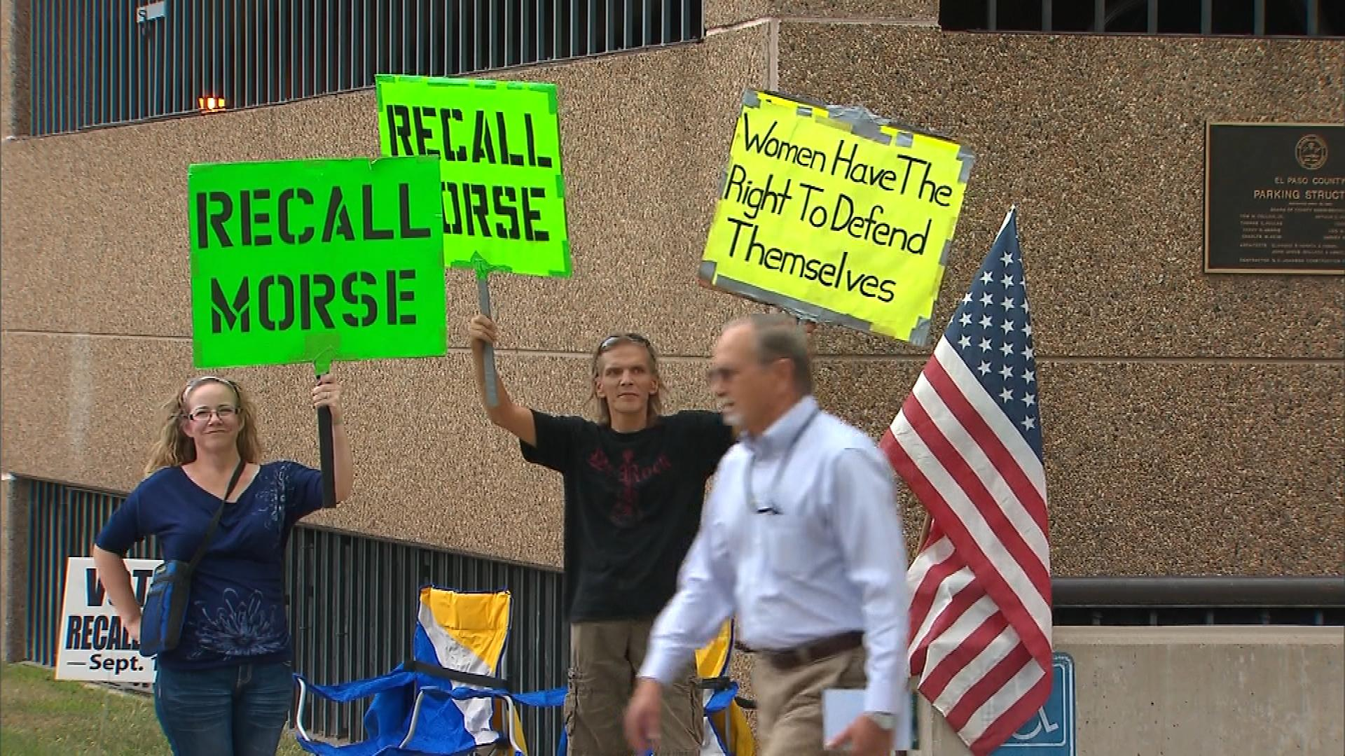 Residents hold up signs during the recall election in September. (credit: CBS)