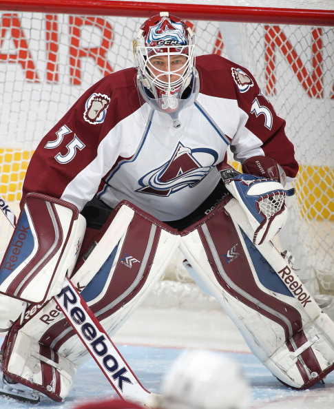 Jean-Sebastian Giguere #35 of the Colorado Avalanche gets set to face a shot in the warm-up prior to playing against the Toronto Maple Leafs during an NHL game at the Air Canada Centre on October 8, 2013 in Toronto, Ontario, Canada. (Photo by Claus Andersen/Getty Images)