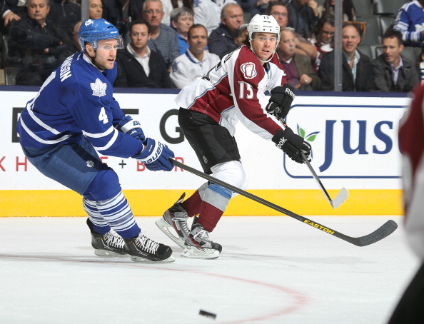 P A Parenteau #15 of the Colorado Avalanche passes the puck in against the Toronto Maple Leafs during an NHL game at the Air Canada Centre on October 8, 2013 in Toronto, Ontario, Canada. (Photo by Claus Andersen/Getty Images)